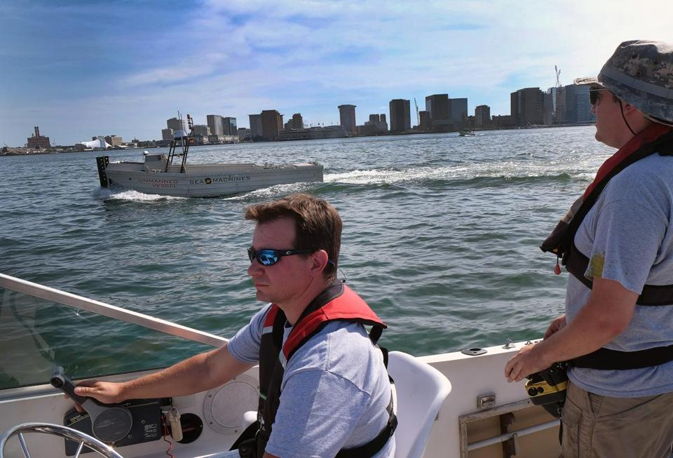 Jeff Bartkowski of Sea Machines took the helm of a chase boat while a colleague controlled one of the company's unmanned vessels during a test run in Boston Harbor.